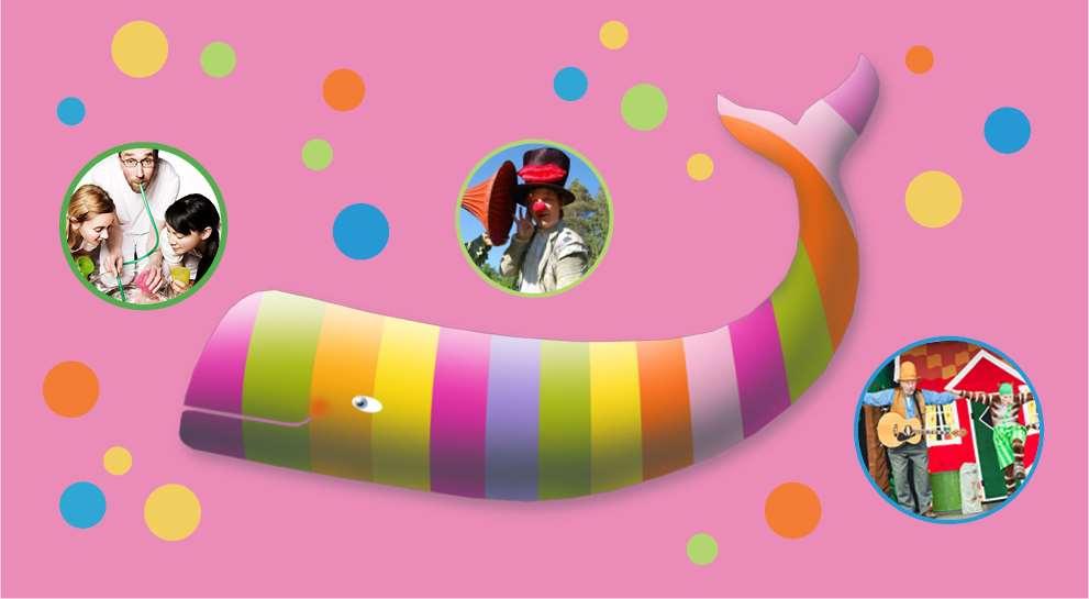 En glad bild med en randig val i olika pastellfärger mot en rosa bakrund. Valen omges av rpickar i olika storlek och färger.